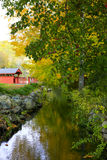 Small river flowing in old village Stock Image
