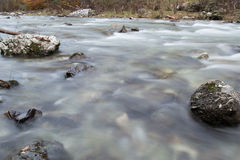 Small river flowing Stock Photo