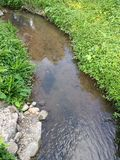 Small river in the garden. Small artificial river in the garden Stock Images
