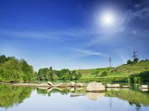 Small river and hills by summer. Royalty Free Stock Photos