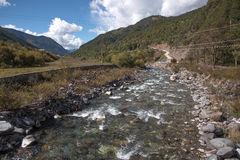 small river with mounatin on road from kunming to Shangri-la, Ch Royalty Free Stock Photo