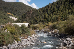 small river with mounatin on road from kunming to Shangri-la, Ch Stock Photo