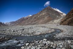 Small river and mountains with snow. Manali to Leh highway. royalty free stock photo