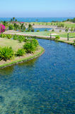 River in park by ocean Stock Photo