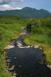 Small river with rocks somewhere in Kamchatka. Russia stock image