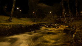 Small river. Running trough a cemetery in the city of narvik in norway stock images