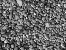 Small river sea stones. summer background. black and white pebble stone matrerial Royalty Free Stock Images