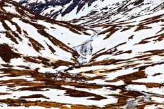 Small river in snowy mountains, Norway Royalty Free Stock Images