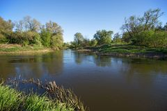 Small river in spring evening stock photos