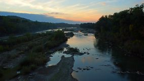 Small river at sunset Stock Photo