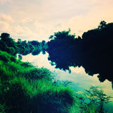 A small river The two sides surrounded by trees. vintage style. Stock Image