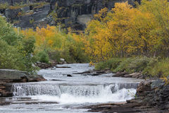 Small river waterfall. Autumn colors Royalty Free Stock Photo
