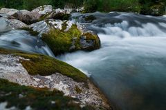 Small rivers with stones in long exposure Stock Photos
