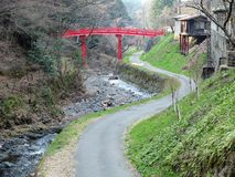 Small Road by The Canal with Red Bridge in Country Side Stock Photography