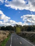 Small Road and Cloudy Sky in California. This image of a small road was taken in a park in Ripon California During Winter 2017 stock photography