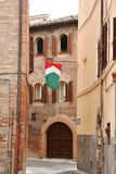 Small road with italian flag in Corinaldo, Marche, Italy Royalty Free Stock Photo
