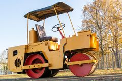 Small road roller. Standing at parking on autumn season royalty free stock photo