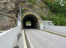 Small road tunnel in stone rock Royalty Free Stock Photos