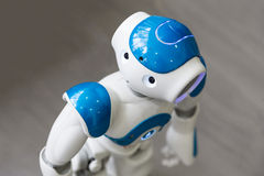 Small robot with human face and body. AI Stock Image