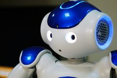 A small robot with a human face and a humanoid body. Artificial intelligence - AI. Blue-and-white robot. A small robot with a human face and a humanoid body stock photos