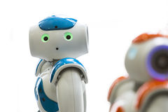 Small robots with human face and body. AI stock photos