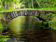 Small rock bridge over forest channel royalty free stock photos