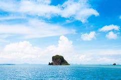 Small rock island near Koh Lanta, Krabi Thailand on clear blue s royalty free stock images