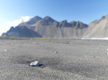 Small rock with mountains in the background Royalty Free Stock Photography