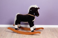 Small rocking horse in room Stock Photography