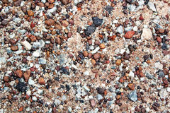 Small rocks. Pile of small rocks with sand stock image