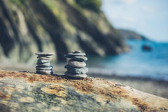 Small rocks placed in formation on the beach Royalty Free Stock Images