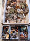 Small Rocks and Polished Agates. Small collectable rock fragments, stones, and polished agates for sale at Milan street stall, market, Italy Stock Photography
