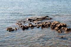 Small rocks in the sea Royalty Free Stock Image