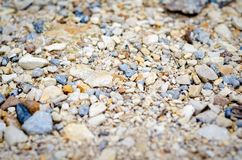 Small rocks on wooded road in nature near a river royalty free stock image