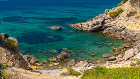 Small rocky beach. With azure water photographed during sunny day at the south coast of Mallorca stock photography