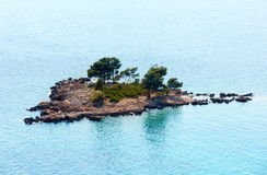 Small rocky island with few trees Royalty Free Stock Photography