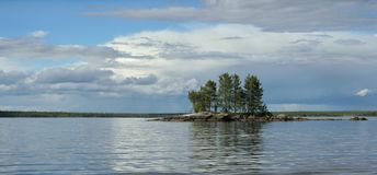 Small rocky island on the lake. Small rocky island with pine trees on Engozero lake, Republic of Karelia, northwest of Russia royalty free stock photography