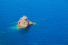 Small rocky island near coast of Corsica, France Royalty Free Stock Images