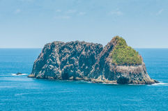 Small rocky island Stock Images
