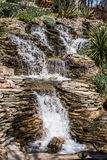 Small rocky waterfall pouring into a lake. Small rocky waterfall pouring into a small lake stock images