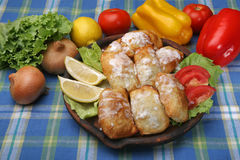Small rolled pies with sour cream Royalty Free Stock Photo