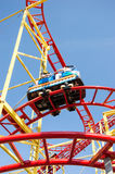 Small Rollercoaster on blue sky Stock Photos