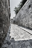 Small roman street between fortress walls Stock Images