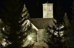small romanesque church with its typical tower made in all stones in the middle of a forest illuminated by night stock photos