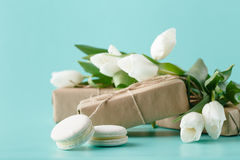 Small romantic present on table with tulips Stock Photo