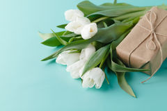 Small romantic present on table with tulips Stock Photos
