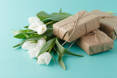 Small romantic present on table with tulips Royalty Free Stock Photography