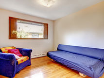 Small room with bright purple furniture Royalty Free Stock Photo