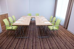 Small room for business training with table in the shape of a. Green comfortable chairs and sheets of paper with pens and glasses on the table royalty free stock photography