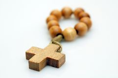 Small rosary. Small wooden rosary on white background Royalty Free Stock Photography